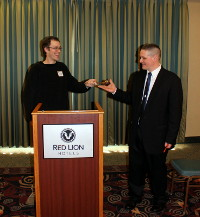 Former LPO State Chair Tim Reeves passes the gavel to incoming Chair Ian Epstein