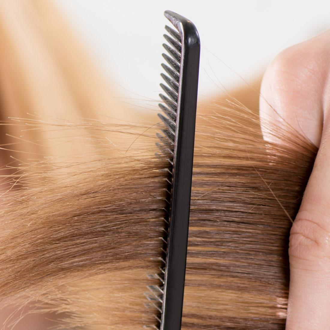 Getting ready to trim a women's hair