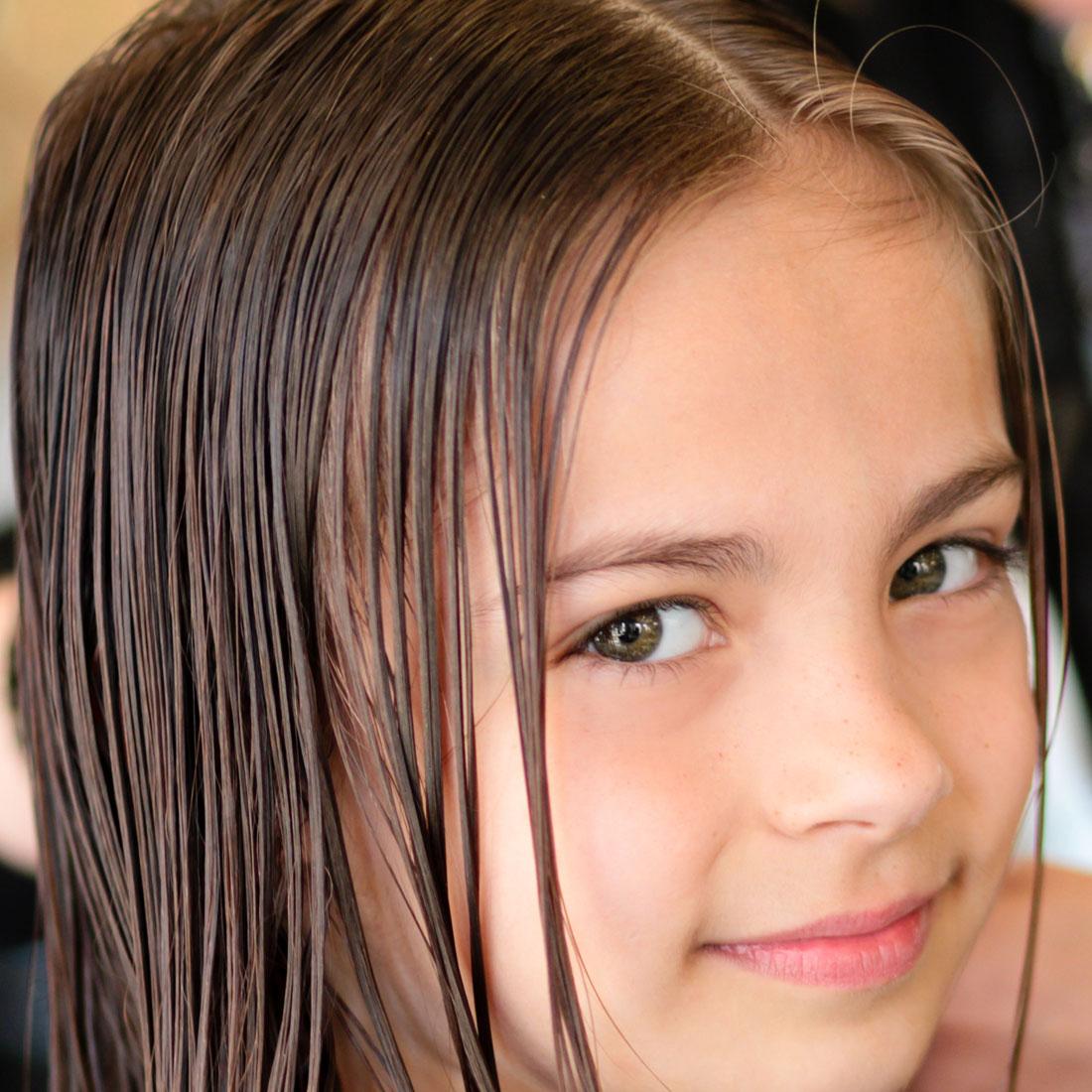 Little girl getting a haircut