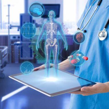 A nurse holding a holographic representation of a human body