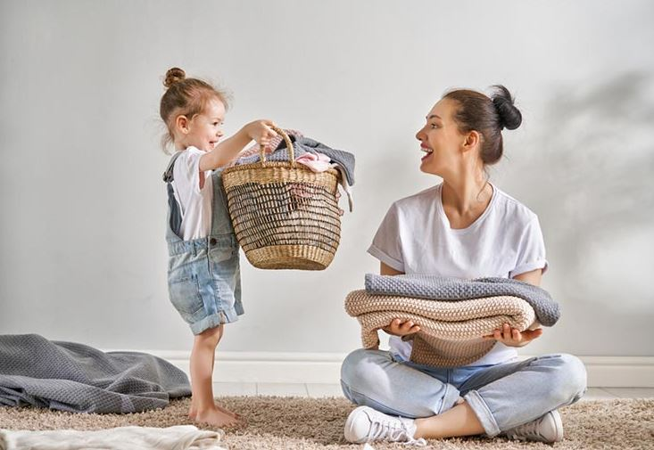 Mom Folding Laundry With Daughter