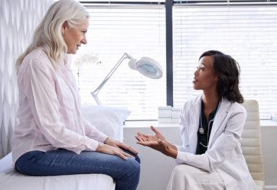 clinician and patient discussing benefits of remote patient monitoring