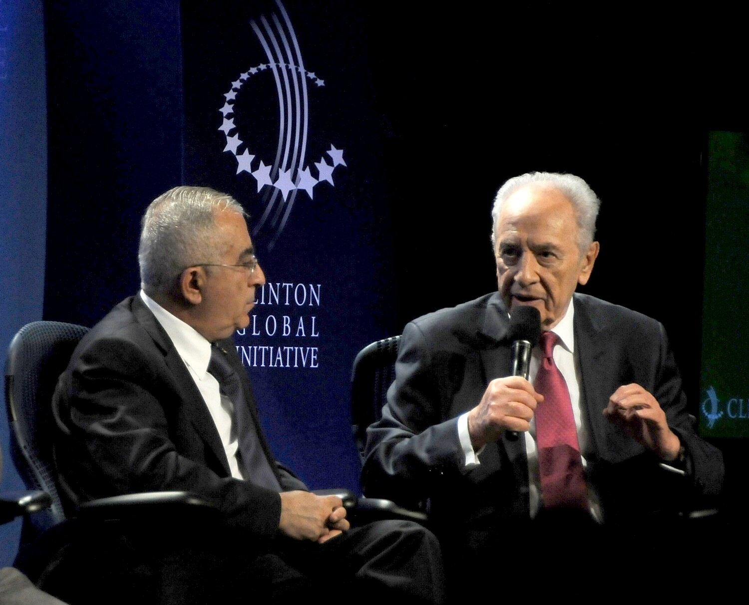 """""""One thing both of us agree –  not just governmental intervention but private initiative…we all are ready to accept high tech in their countries- that has nothing to do with territory… it's global,"""" Israel President Shimon Peres tells Palestine National Authority Prime Minister Salam Fayyad at 2010 Clinton Global Initiative. """"We are ready in Israel to share what we have."""" © 2016 Karen Rubin/news-photos-features.com"""