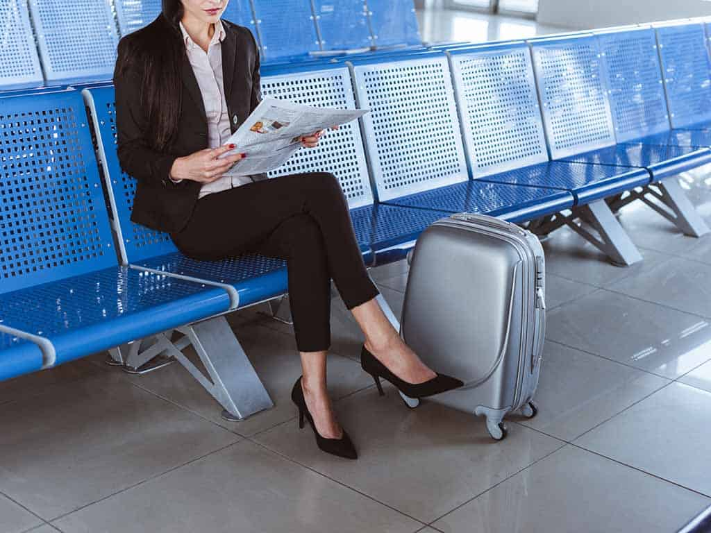 business travel hacks woman airport traveler record streaming video Mac