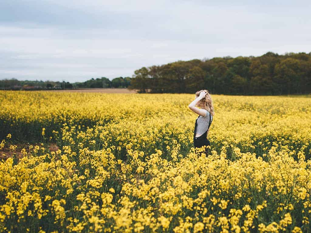 mindful methods calm amid chaos woman yellow flower field thinking