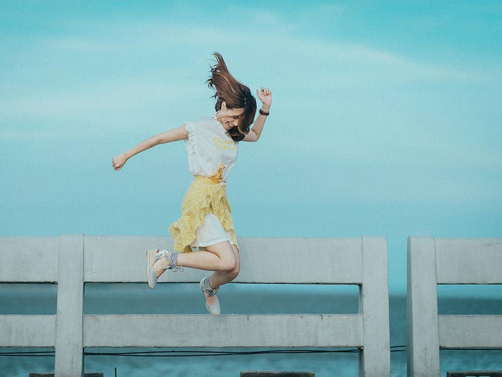 changing habits woman jumping happy