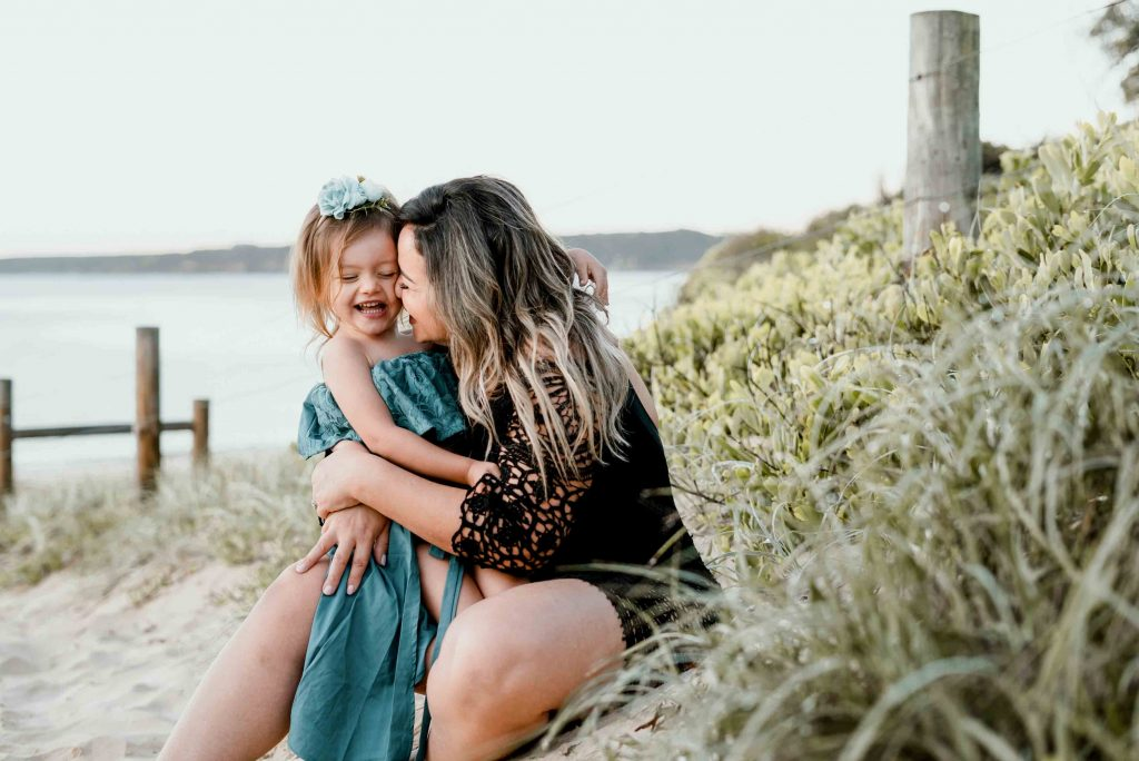 mum hugging child and kid laughing