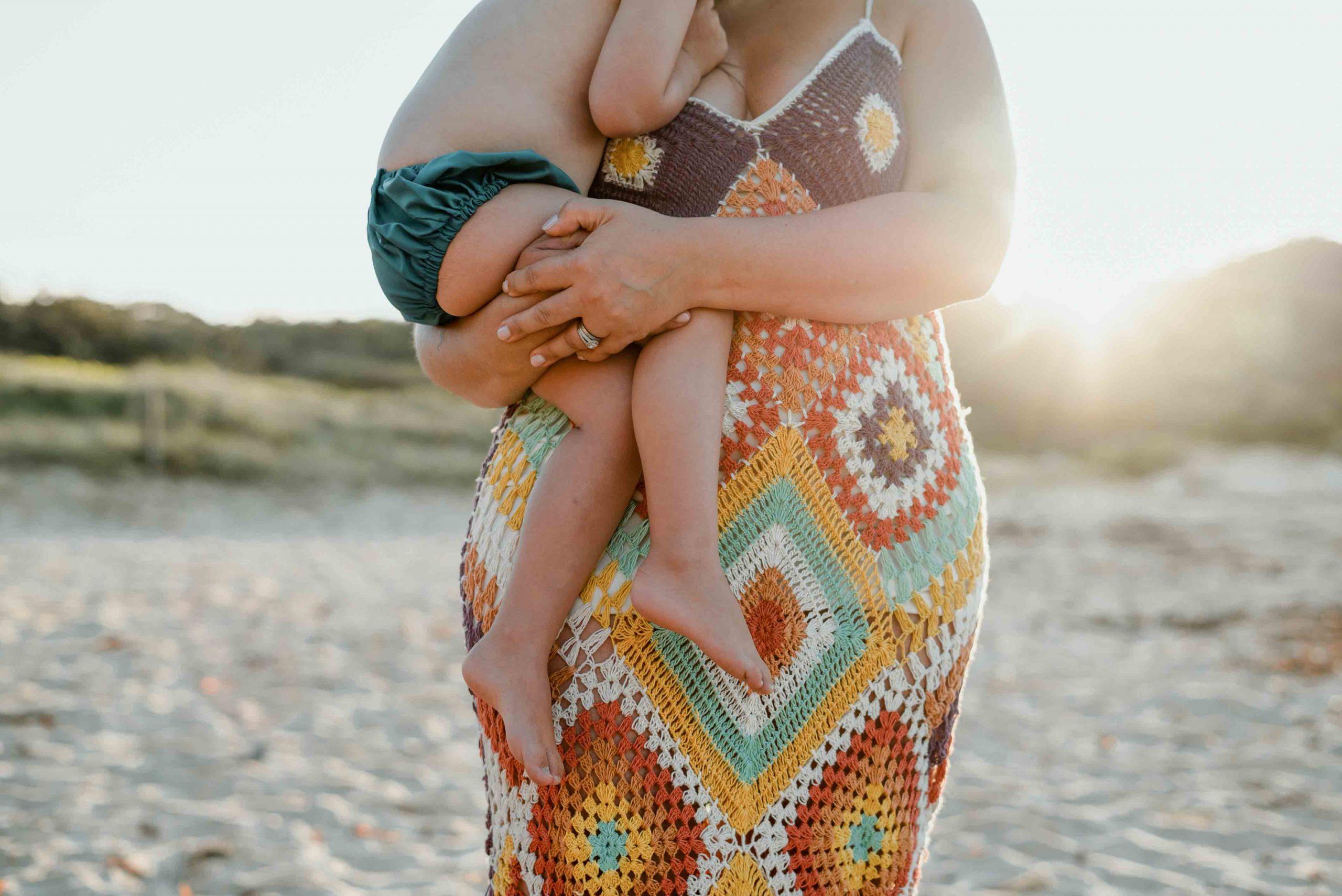 close-up of foot of mum hugging child