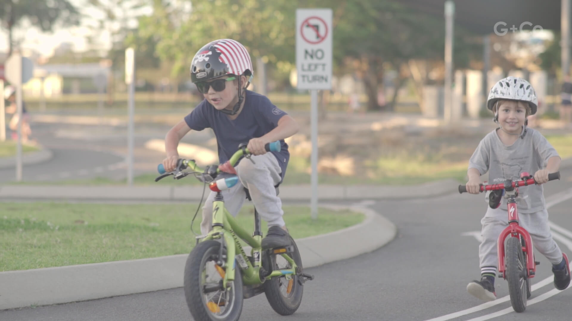 still frame from creative documentary film: kids riding a bike