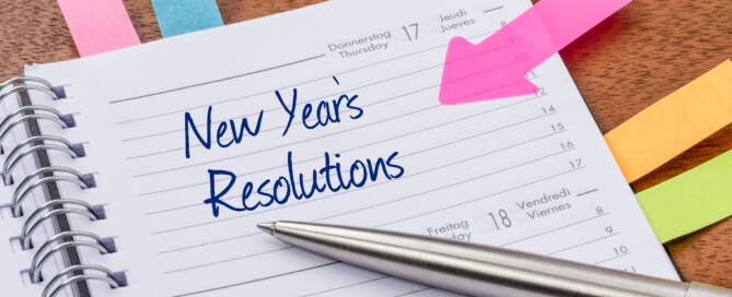 Writing out New Year's Resolutions in Journal