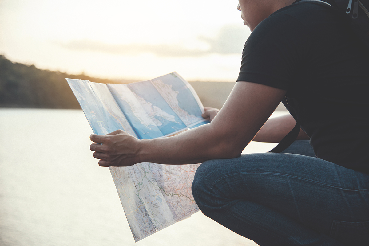 Tourist looking at Map Outside