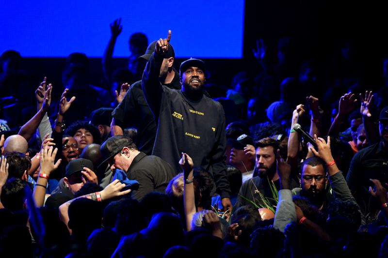 Kanye West Worshiping in Crowd