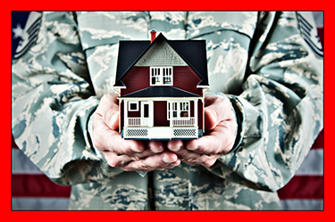 military veteran holding small doll house