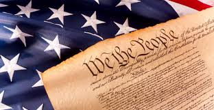 Image of the Constitution with an American Flag