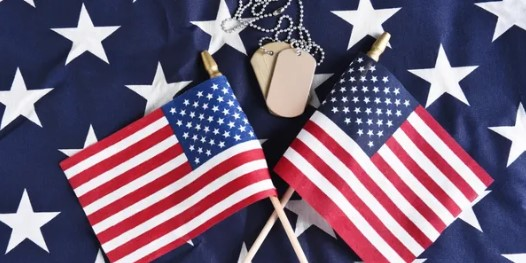Smaller flags on top of one flag with dog tags