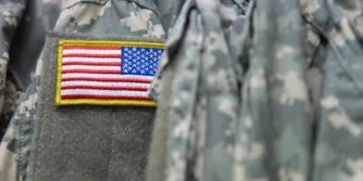 Soldier fatigues with flag patch