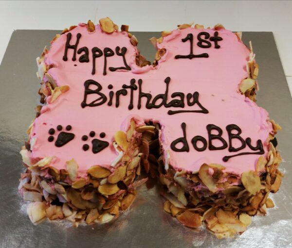 pink icing bone carob cake