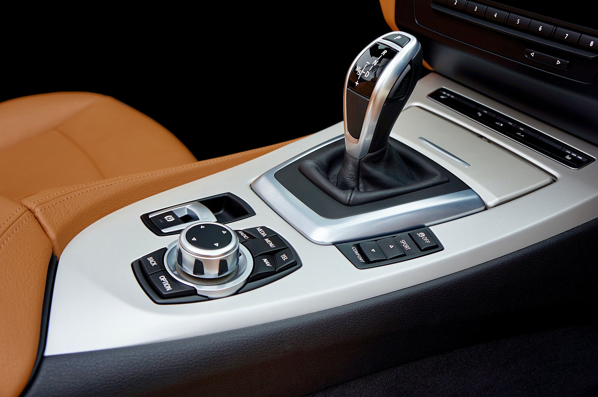 Close up of vehicle gear stick with control options