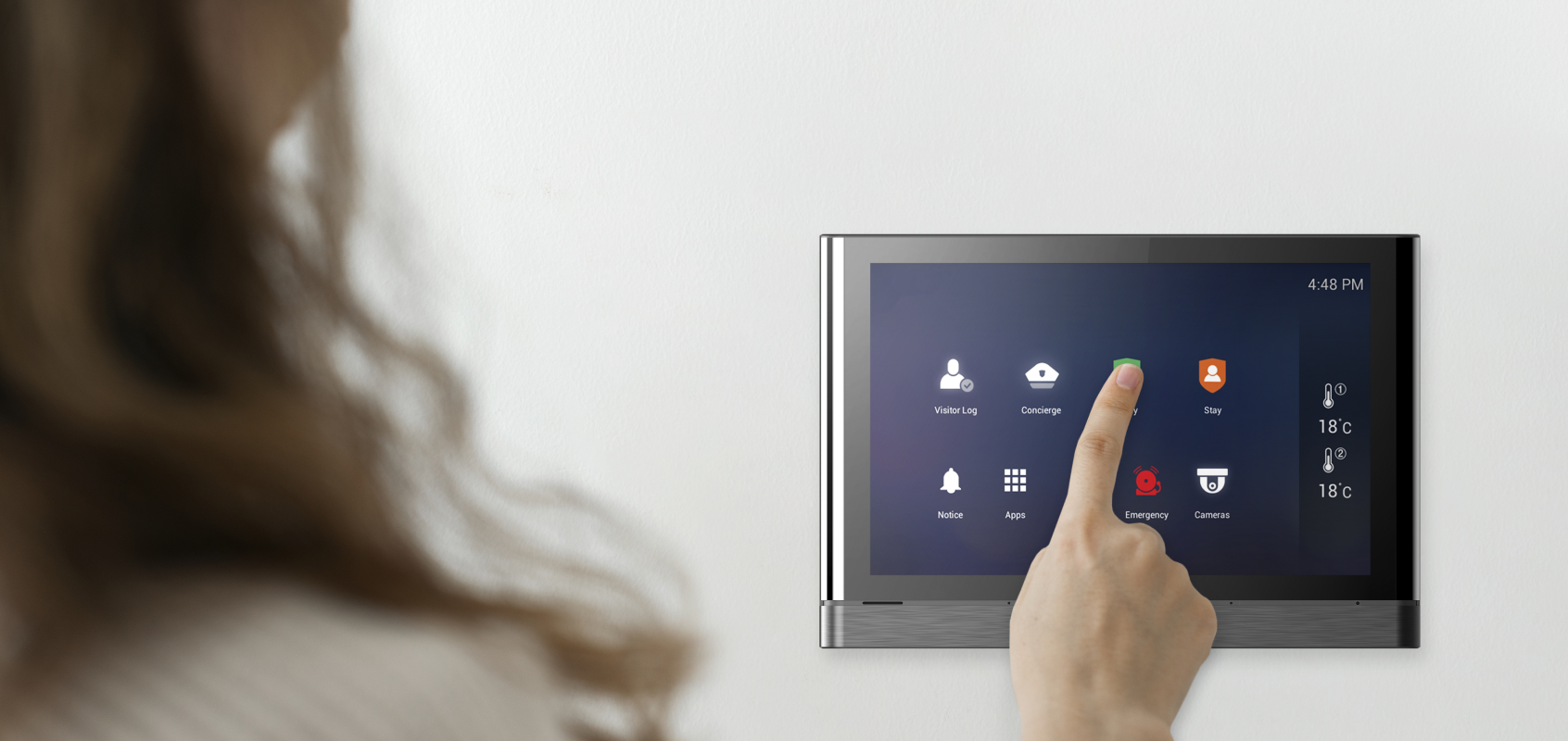 Woman touching SmartONE wall pad screen with her finger