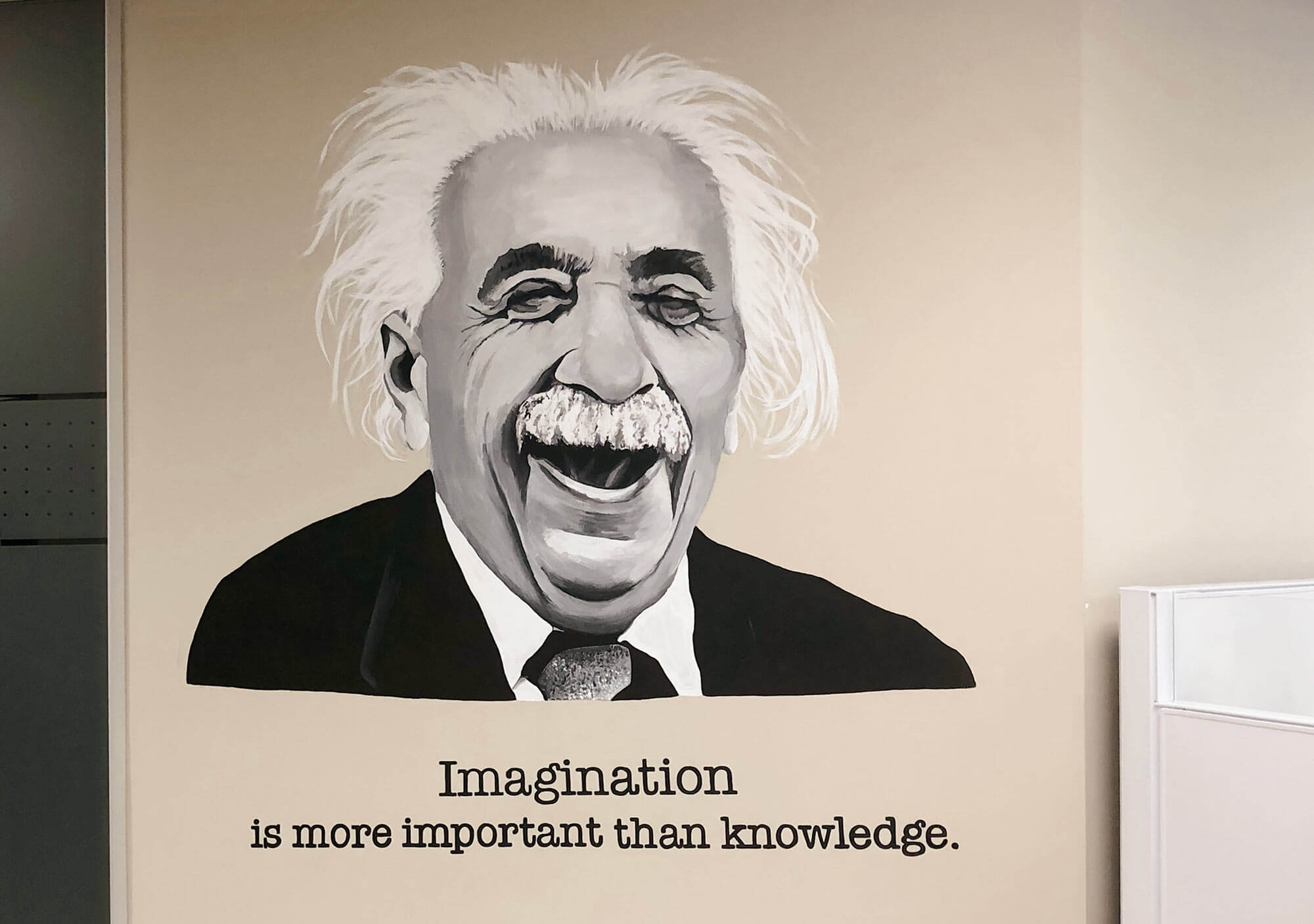 Painting of Albert Einstein laughing with his quote
