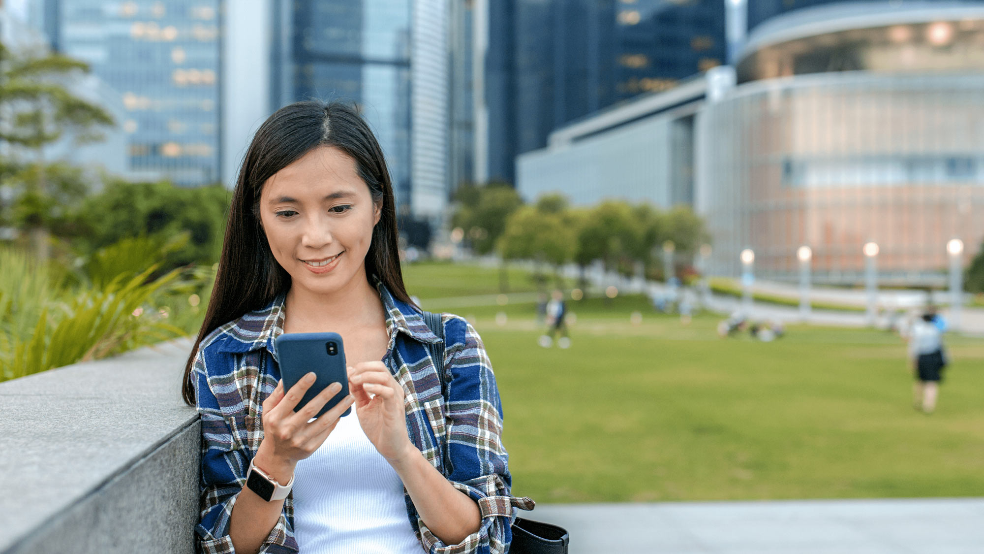 Young woman using her mobile phone outdoors