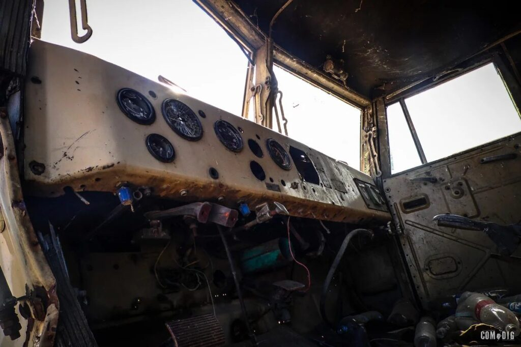 20 Decaying Trucks and Boat Photos on the Russian Island of the Volga River