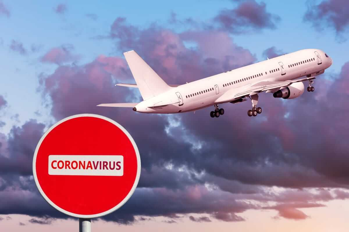 Aircraft taking off with coronavirus warning sign