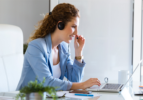 Portrait of customer service operator talking on phone in the office.
