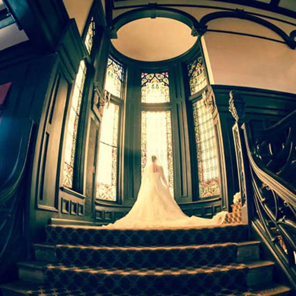 Bride in front of large windows
