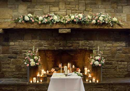 Decorated bridal party table with rustic wedding flowers