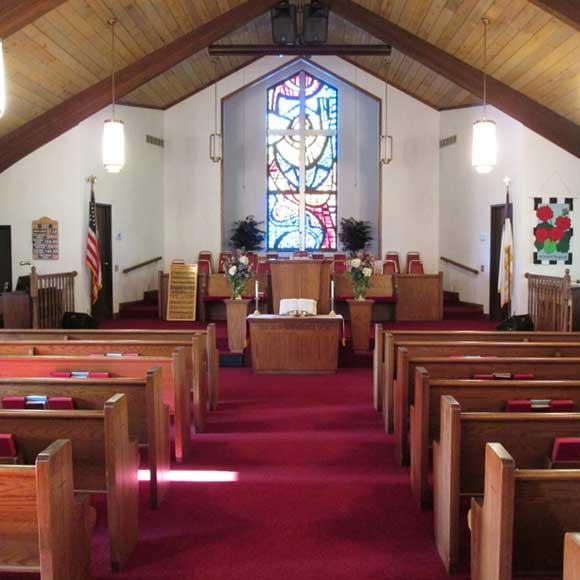 Inside of church; main aisle between pews