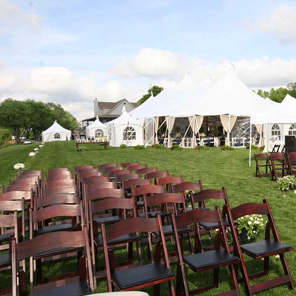 Outdoor rows of seating for a outside wedding