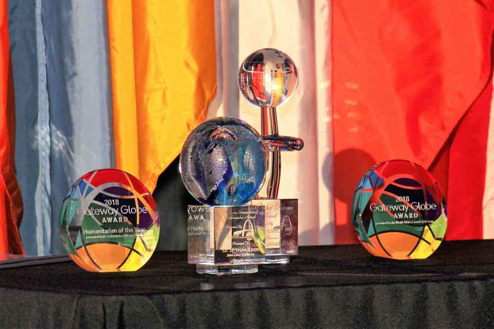 World Affairs STL Gateway Globe Awards Displayed on Table