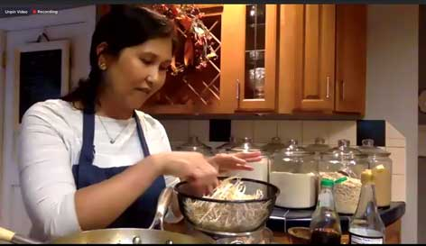 Chef Naam Pruitt demostrates how to make Pad Thai for World Affairs Council of St. Louis members