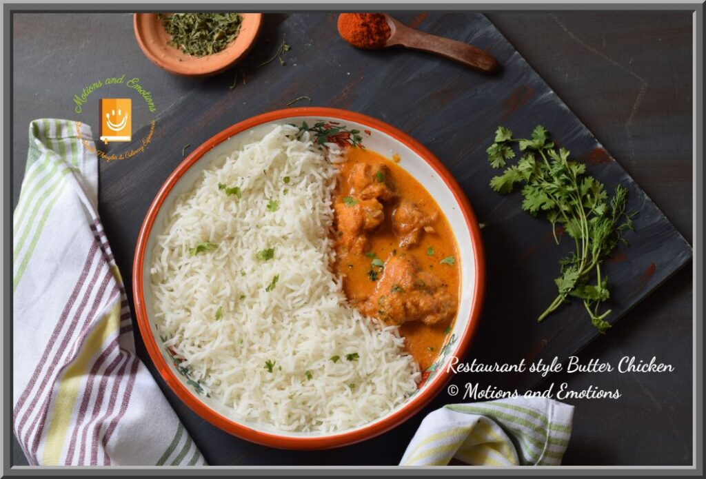 Butter chicken and rice in a white plate along with spices