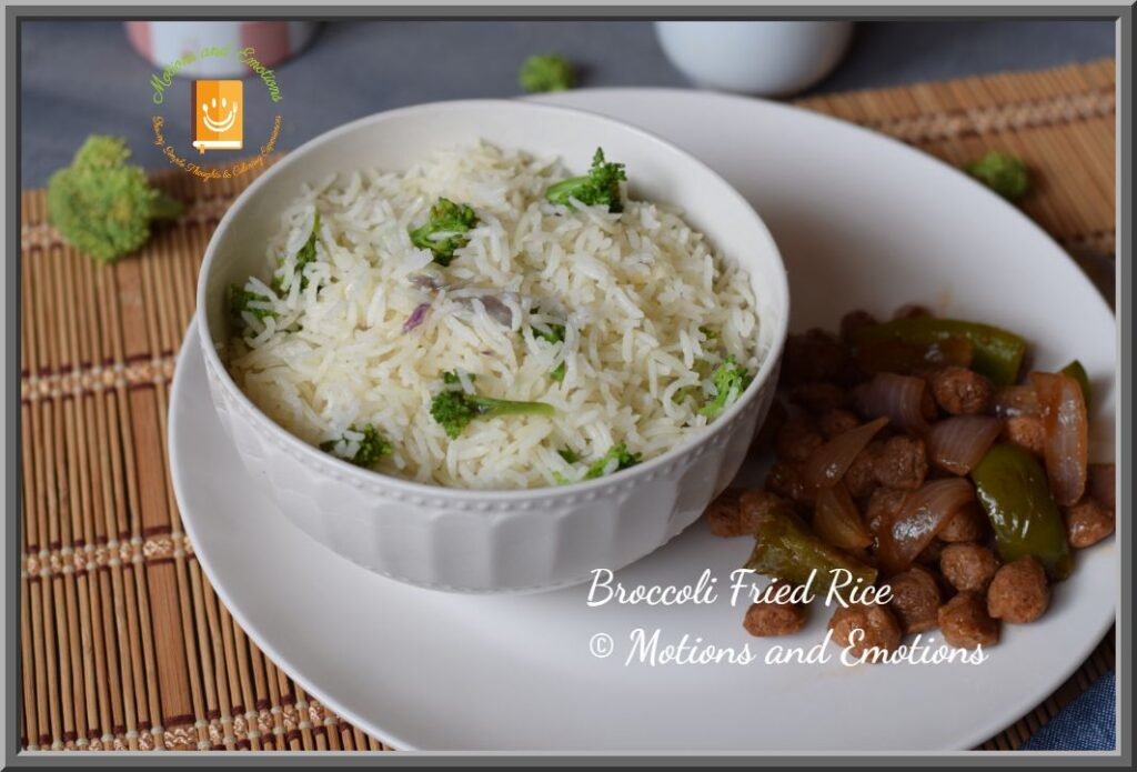 Broccoli Fried Rice in a white bowl served with soya chunks in soya sauce
