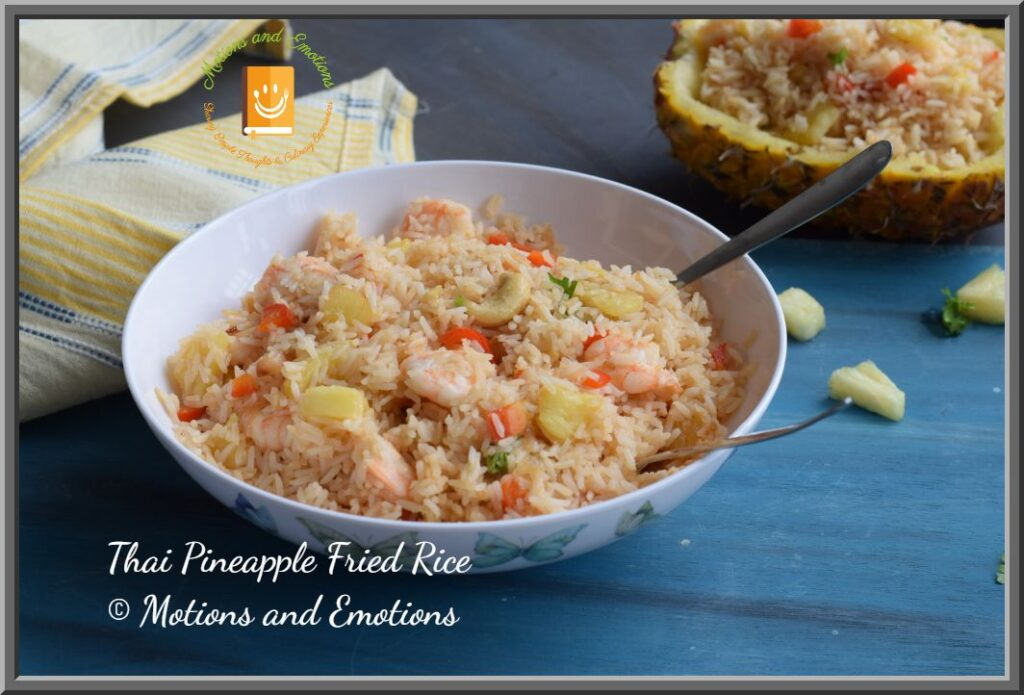 Thai pineapple fried rice served in a white bowl side view