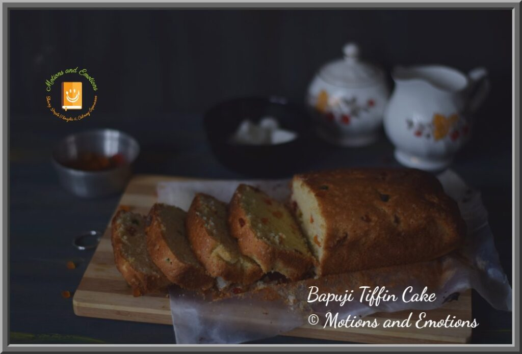 Bapuji Tiffin Cake Sliced on a wooden board side view