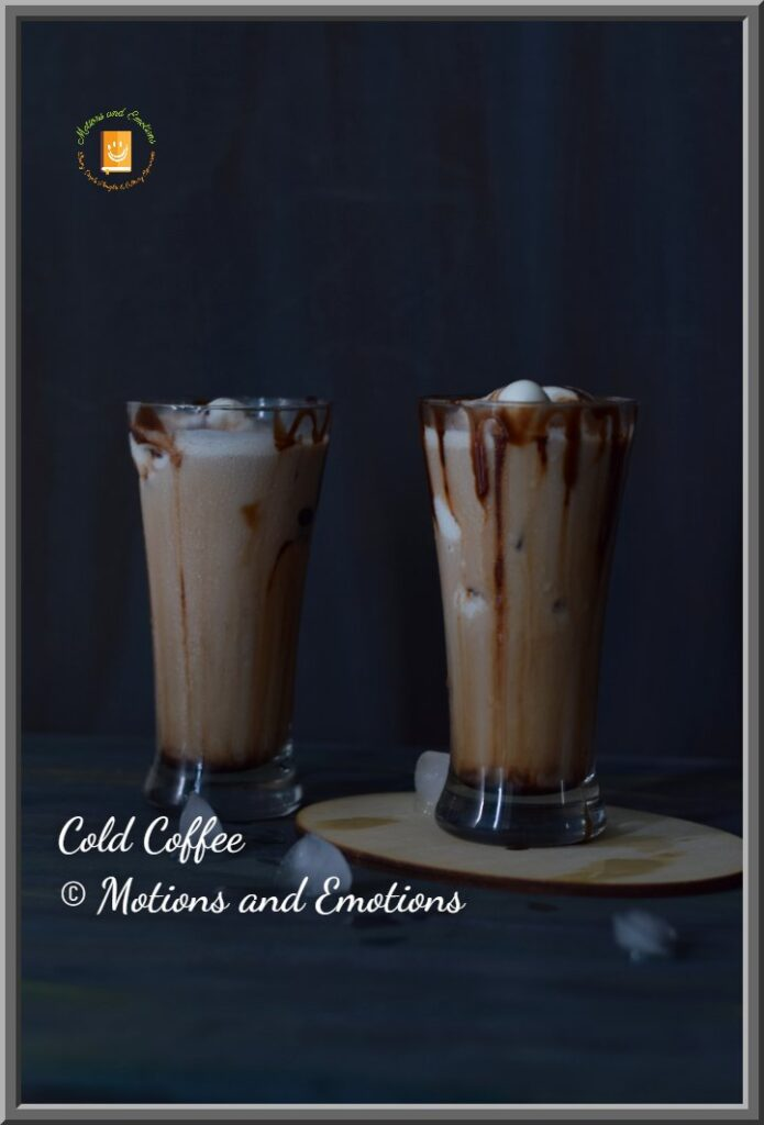 Cold coffee in two tall glasses and some ice cubes