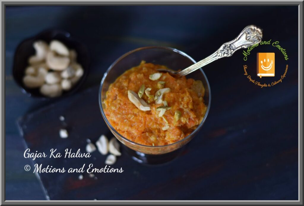 Gajar ka halwa topped with nuts served in a dessert bowl top view