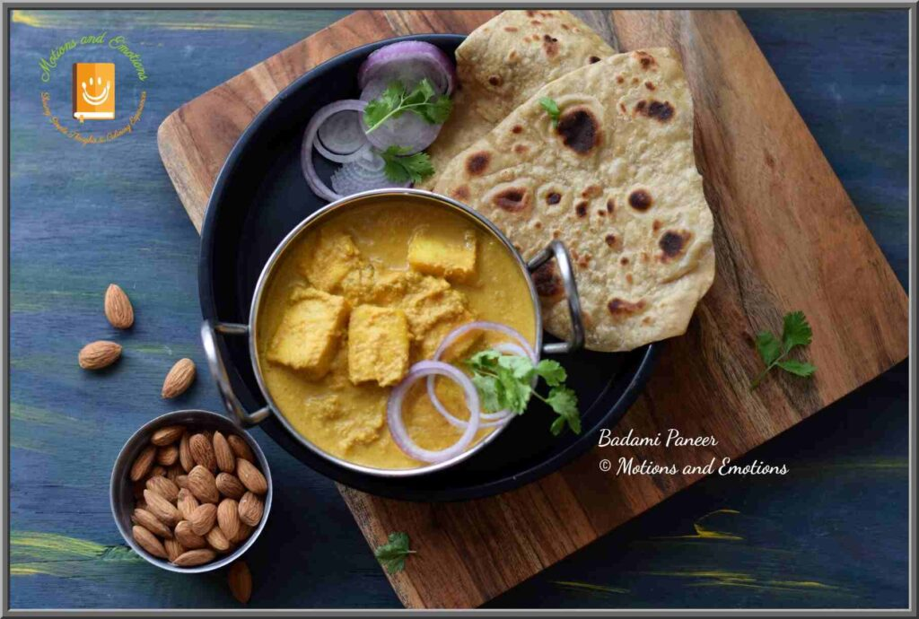 Badami paneer served in a small wok along with paratha