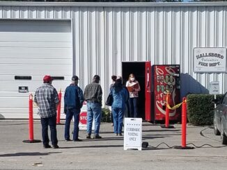 Hallsboro saw lines stretching to the other end of the fire station at times Tuesday morning. (Jefferson Weaver photo)