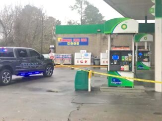 Crime scene tape surrounded the gas pumps and front door of the Sam's Pit Stop Saturday after a man was stabbed.