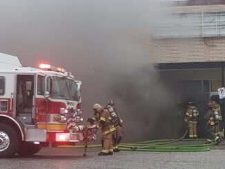 Firefightersprepare to enter the closed Radio Shack during Friday's fire.