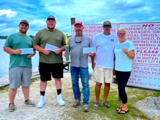 Left to right: Third place winners Dalton Pridgen and Hugh Smith (who took home the prize for Biggest Bass, at 6.1lbs); first place winner John Norris with a bundle weighing 20.4 lbs; and second place winners Tom Elliott and Lindsey Musselwhite.