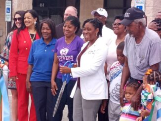 Dr. A. Nicole Jenkins is surrounded by family and friends as she officially opened her practice in Whiteville.