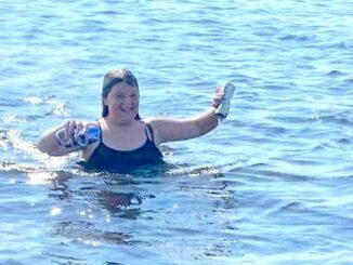 Lakyn Wilson took it upon herself to collect bottles and cans from Lake Waccamaw after a another girl cut her foot on a broken bottle.
