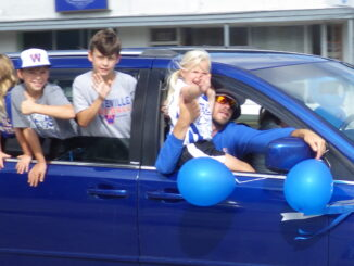 The Central Columbus Dixie Darlings Rolle dthrough downtown Whiteville this morning en route to the state championships.