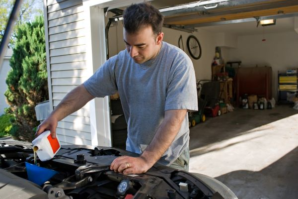 Why You Should Hire Professional Help for Your Garage Door Repairs