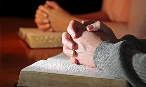 Praying Hands Bibles Couple